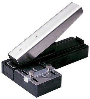 Stapler-Style Slot Punch with Adjustable Centering Guide and slot receptacle